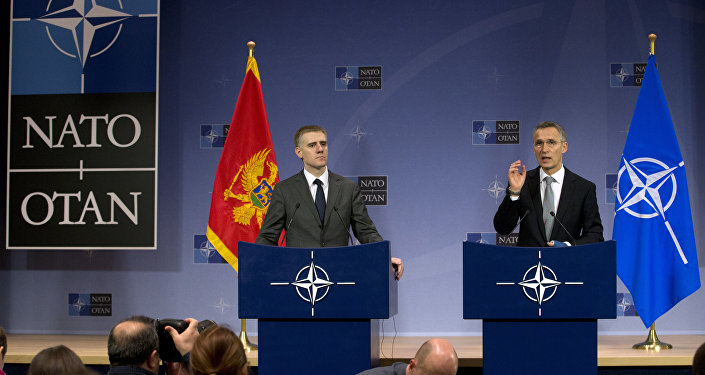 NATO Secretary General Jens Stoltenberg, right, and Montenegro's Foreign Minister Igor Luksic address a media conference at NATO headquarters in Brussels on Wednesday, Dec. 2, 2015