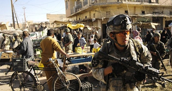 U.S. Army Spc. Kon Im and his squad move through an open-air market during a foot patrol in Baqubah, Iraq, April 5, 2007.