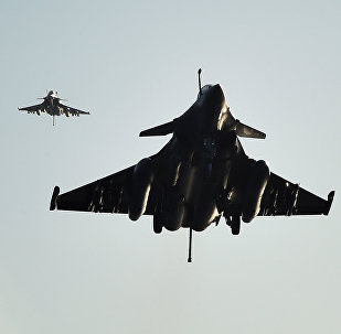 French Rafale fighter aircrafts come back aboard the French Charles-de-Gaulle aircraft carrier, after flights on November 23, 2015 at eastern Mediterranean sea, as part of operation Chammal in Syria and Irak against the Islamic State group
