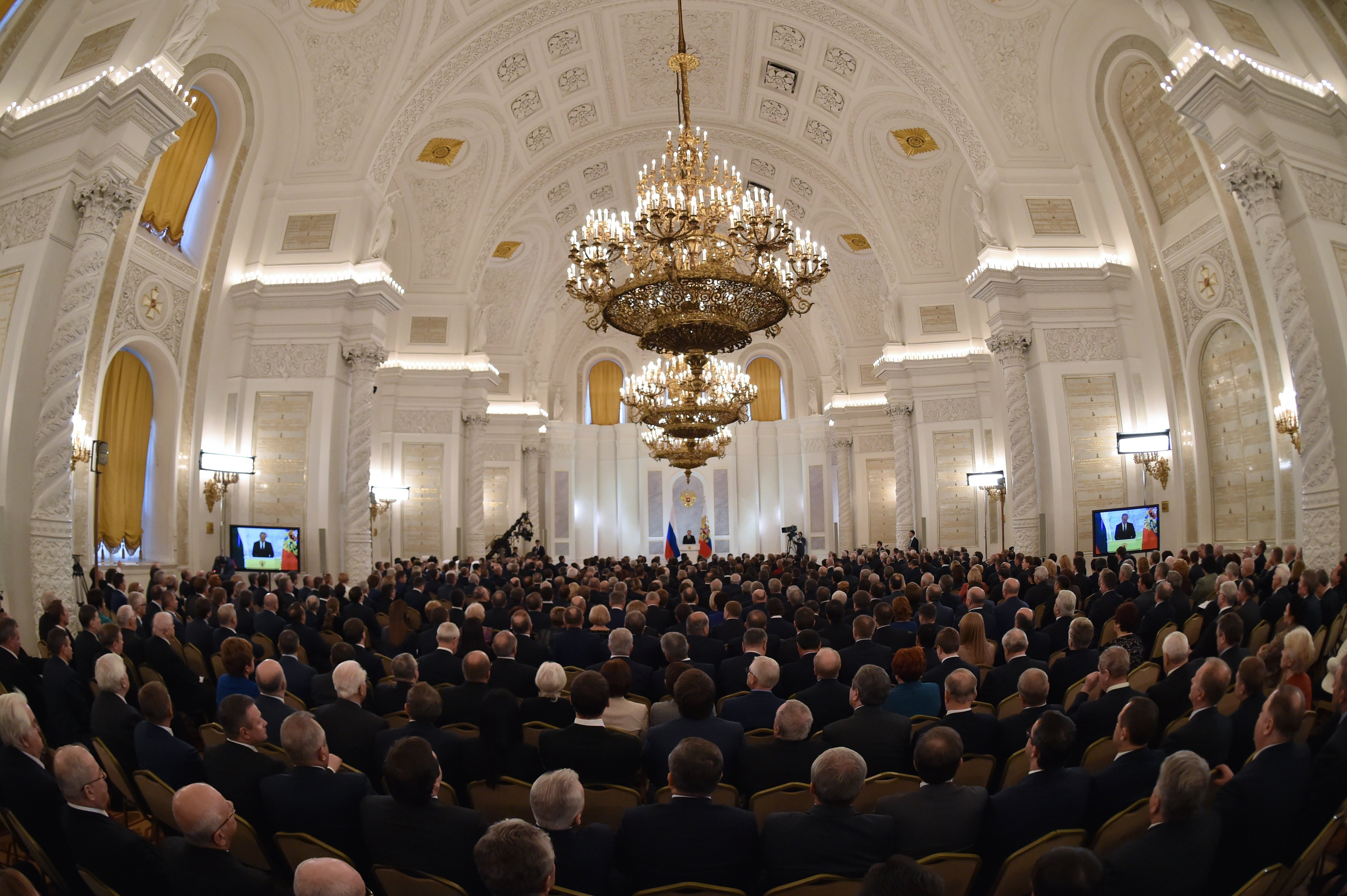 Russian President Vladimir Putin (C back) delivers his annual state of the nation address at the Kremlin in Moscow on December 3, 2015