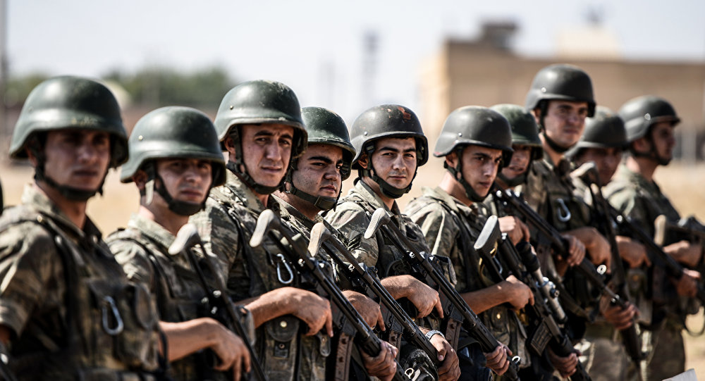 Turkish soldiers stand guar.