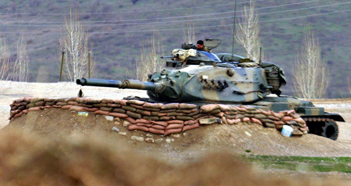 Turkish Army tank stands ready near the village of Bamarni, 30km deep inside northern Iraq