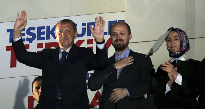 Turkey's President Recep Tayyip Erdogan, his son Bilal Erdogan and daughter Sumeyye Erdogan salute supporters from the balcony of his ruling party headquarters in Ankara.
