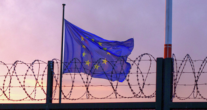 European Union flag behind a wired fence