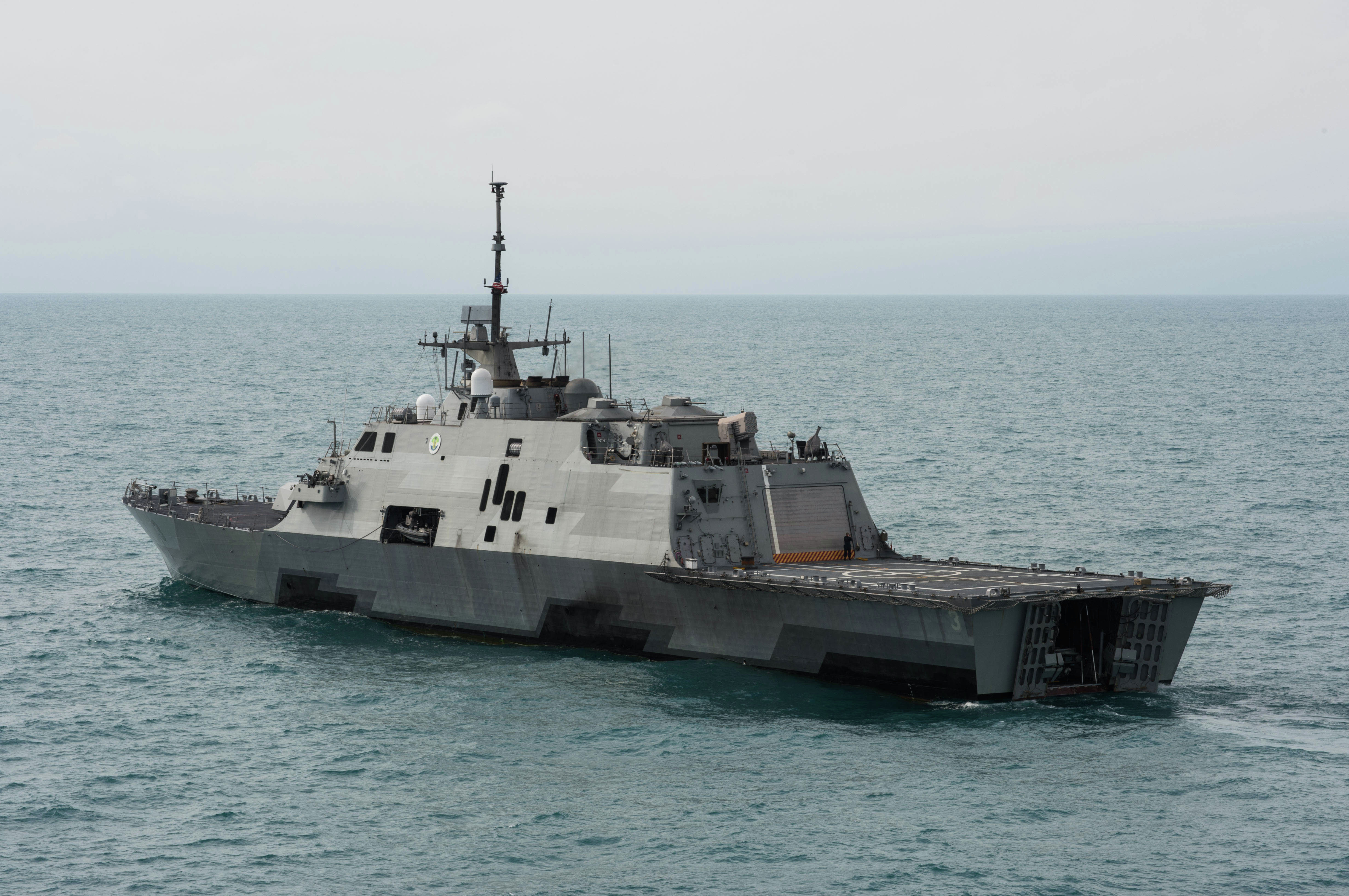 This US Navy handout photo released January 8, 2015 shows the littoral combat ship USS Fort Worth (LCS 3) as it operates on January 7, 2015 near the location where the tail of AirAsia Flight QZ8501l was discovered. Fort Worth is currently supporting Indonesian-led efforts to locate the downed aircraft.
