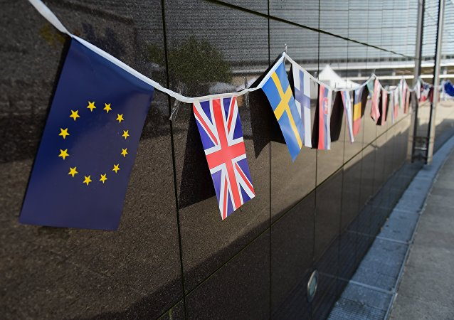 An European flag and a British flag stand next to each others outside the European Commission building, in Brussels, on May 8 2015.