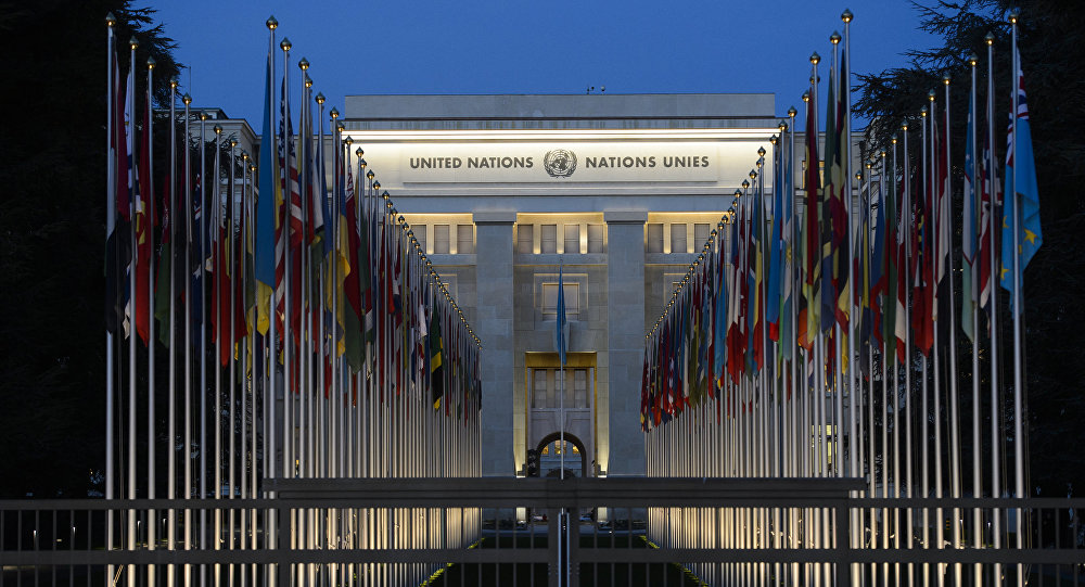 A picture taken on December 10, 2015 shows the United Nations headquarters in Geneva at dusk
