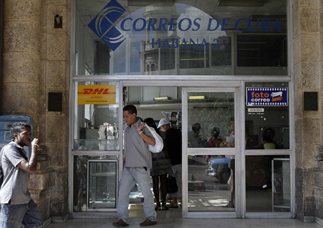 A man leaves a postal office in Havana, Cuba