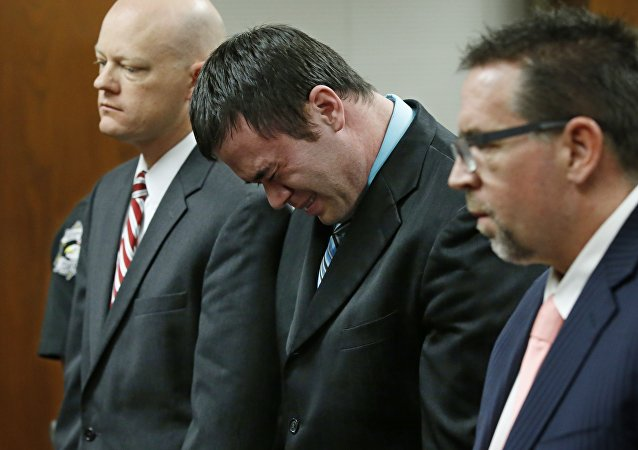 Daniel Holtzclaw, center, cries as he stands in front of the judge after the verdicts were read in his trial in Oklahoma City, Thursday, Dec. 10, 2015.