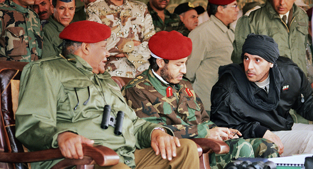 In this undated file photo made available Sunday, Sept. 25, 2011, al-Saadi Gadhafi, center, and Hannibal Gadhafi, right, sons of Libyan leader Moammar Gadhafi, are seen in the audience at a military exercise by the elite military unit commanded by their brother, Khamis, in Zlitan - 90 miles (140 kilometers) southeast of Tripoli, Libya.