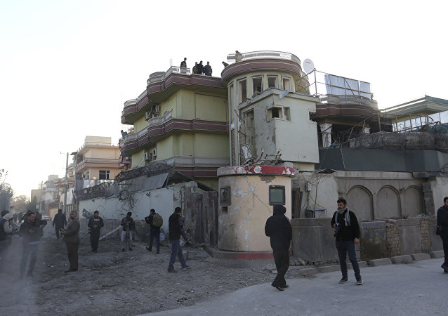 Afghan security perssonel inspect the Spanish Embassy in Kabul, Afghanistan, Saturday, Dec. 12, 2015