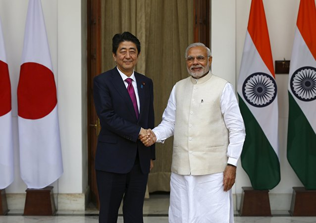 Japan's Prime Minister Shinzo Abe (L) shakes hands with his Indian counterpart Narendra Modi during a photo opportunity ahead of their meeting at Hyderabad House in New Delhi December 12, 2015