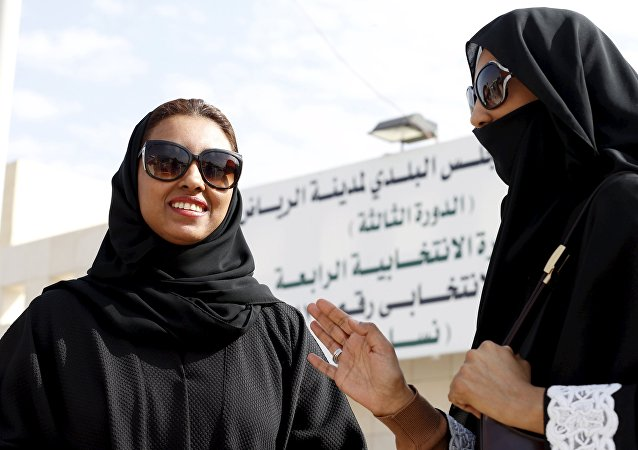 Saudi women leave a polling station after casting their votes during municipal elections, in Riyadh, Saudi Arabia December 12, 2015