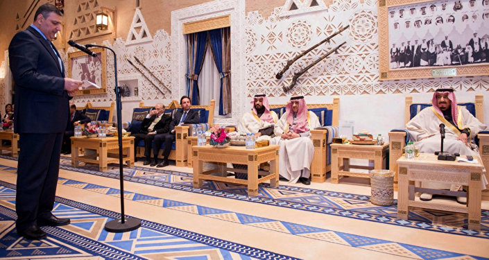 A picture provided by the Saudi Press Agency (SPA)on December 10, 2015 shows Saudi King Salman bin Abdelaziz (R) listening to a member of the Syrian opposition during their meeting in Riyadh.