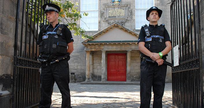 Police are seen outside Canongate Kirk in Edinburgh, Scotland