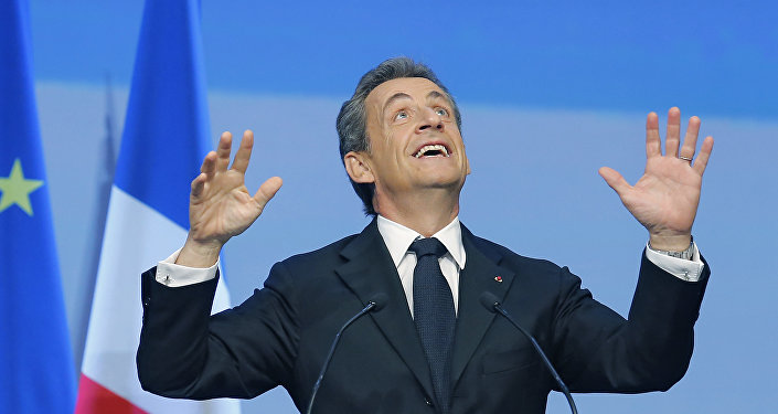 French Former President Nicolas Sarkozy reacts during the meeting of Conservative Republicans at the launch of the campaign for regional elections in Nogent-sur-Marne, outside Paris, Sunday, Sept.