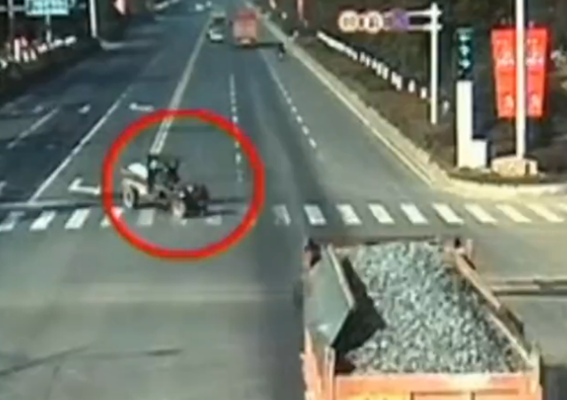 Yikes! Tractor Vs. Truck in China