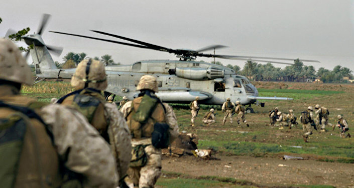 US Marines are picked up by a helicopter after conducting a cordon and knock in al-Qaim, near the Syria border, western Iraq (File)