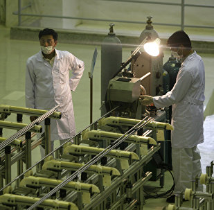 In this April 9, 2009 file picture Iranian technicians work at a new facility producing uranium fuel for a planned heavy-water nuclear reactor, just outside the city of Isfahan, 255 miles (410 kilometers) south of the capital Tehran