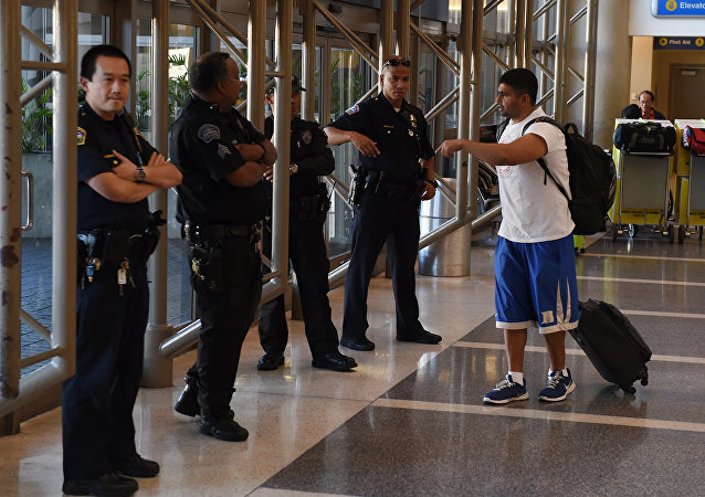 Police keep watch over passengers at Los Angeles International Airport after the US State Department issued a worldwide travel alert warning US citizens of the heightened risks of traveling due to increased terrorist threats November 23, 2015 in Los Angeles, California