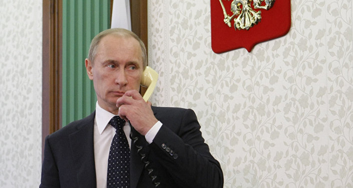 Russian President Vladimir Putin talks on the phone. File photo
