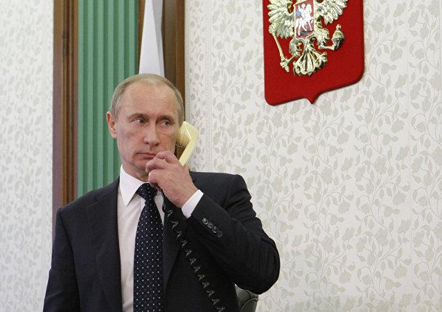 Russian President Vladimir Putin talks on the phone. File photo