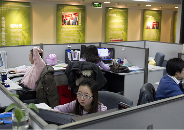 Employees of Dagong Global Credit Rating Co. work at the company's office in Beijing, China