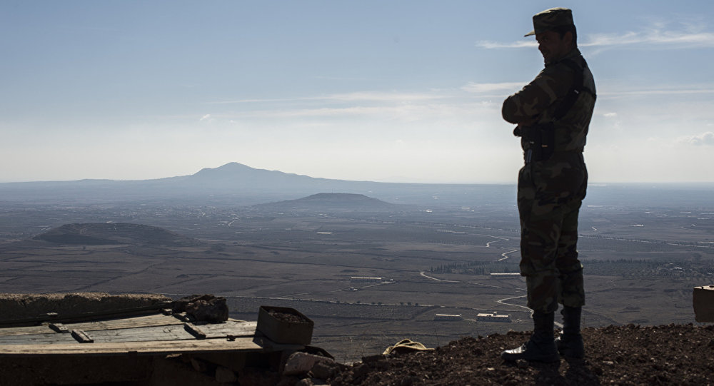 A soldier of the Syrian Arab Army at an observation post at the frontline in the al-Kom village of the Quneitra province in Syria