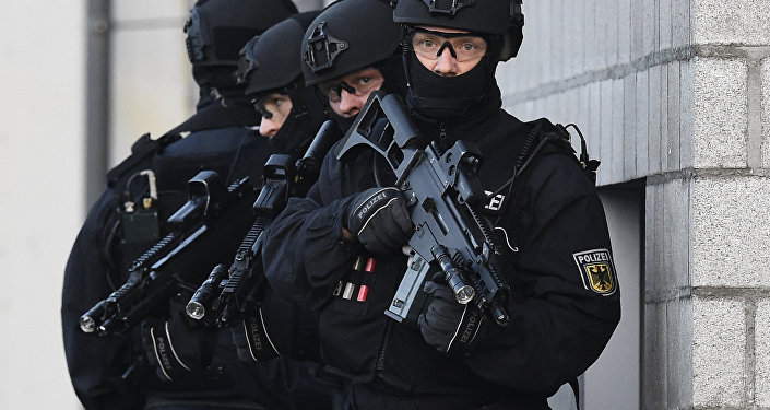 Members of the German police's so-called BFE+ (Evidence and Arrestment Unit) anti terror unit present a training operation in Berlin's Ahrensfelde district on December 16, 2015.