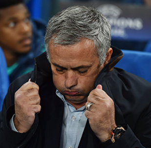 A picture taken on November 4, 2015 shows Chelsea's Portuguese manager Jose Mourinho pulling up the collar on his coat during a UEFA Chamions league group stage football match between Chelsea and Dynamo Kiev at Stamford Bridge stadium in west London