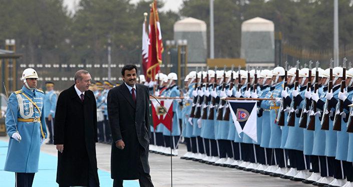 Turkish President Recep Tayyip Erdogan and Qatar's Emir Sheikh Tamim bin Hamad Al-Thani, right, inspect a military honour guard at the new presidential palace in Ankara, Turkey, Friday, Dec. 19, 2014.