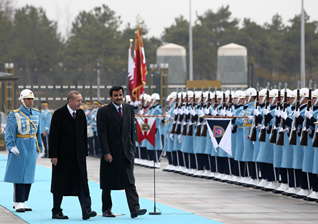 Turkish President Recep Tayyip Erdogan and Qatar's Emir Sheikh Tamim bin Hamad Al-Thani, right, inspect a military honour guard at the new presidential palace in Ankara, Turkey, Friday, Dec. 19, 2014.