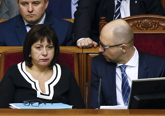 Ukraine's Prime Minister Arseny Yatseniuk (R) and Finance Minister Natalia Yaresko attend a session of parliament in Kiev, Ukraine, December 17, 2015