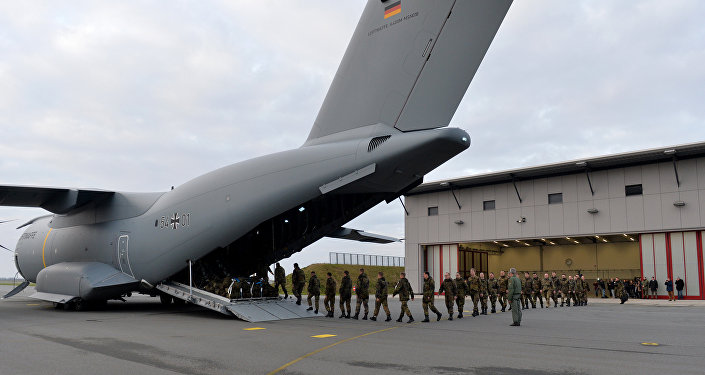 Personnel of the 51st squadron Immelmann enter an Airbus A400M military aircraft before taking off from the German army Bundeswehr airbase in Jagel, northern Germany, December 10, 2015. Germany deploys two Tornado reconnaissance jets and 40 troops to Turkey to back the fight against the Islamic State group in Syria