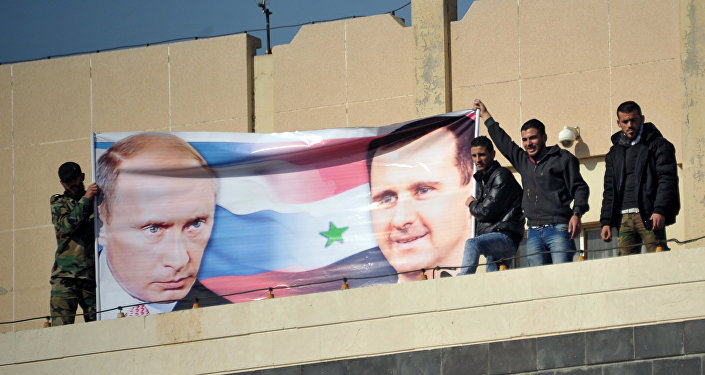 Al-Baath University students hold a rally in Homs in support of Russia's military operation in Syria