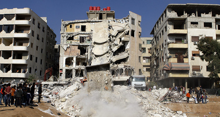 A general view taken on December 20, 2015, shows a bulldozer clearing debris from the site of a reported Israeli air raid that killed a senior figure in the Lebanese Shiite militant group Hezbollah, Samir Kantar, in Jaramana, southeast of the Syrian capital Damascus.