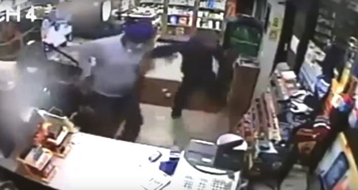 Screenshot from CCTV in which Amrick Singh fights off a would-be robber with a slipper