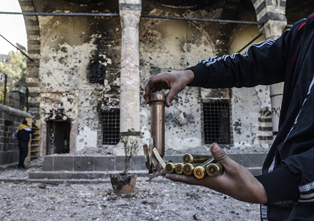 A boy shows bullets used during clashes between Kurdish fighters and Turkish special forces in the Sur district in Diyarbakir on December 11, 2015.