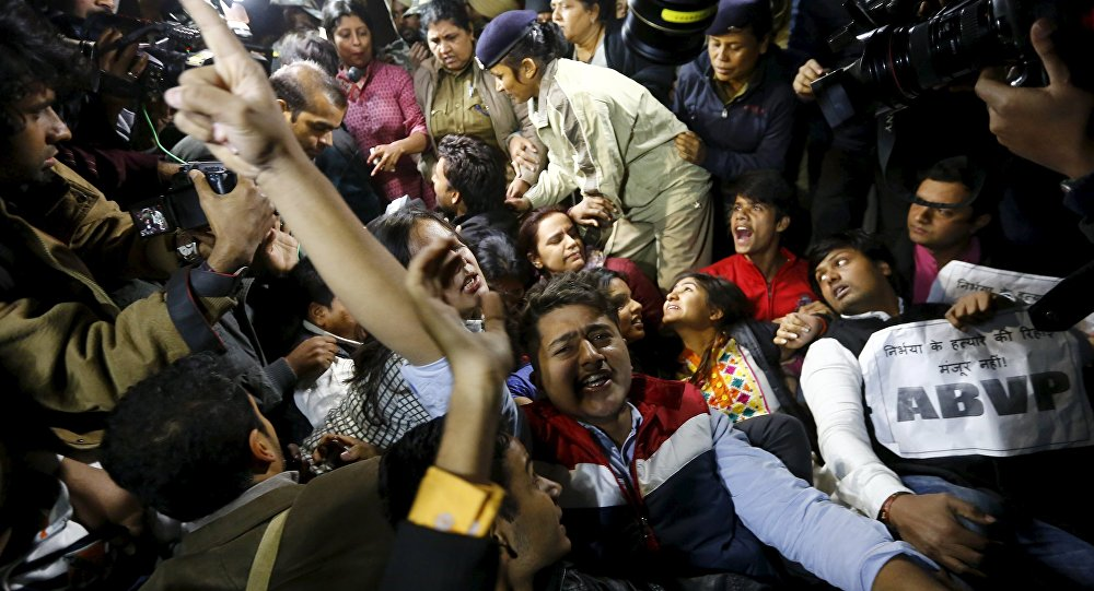 Demonstrators shout slogans as police detain others during a protest against the release of a juvenile rape convict, in New Delhi, India, December 20, 2015