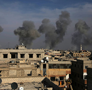 Smoke billows in the town of Douma in the eastern Ghouta region