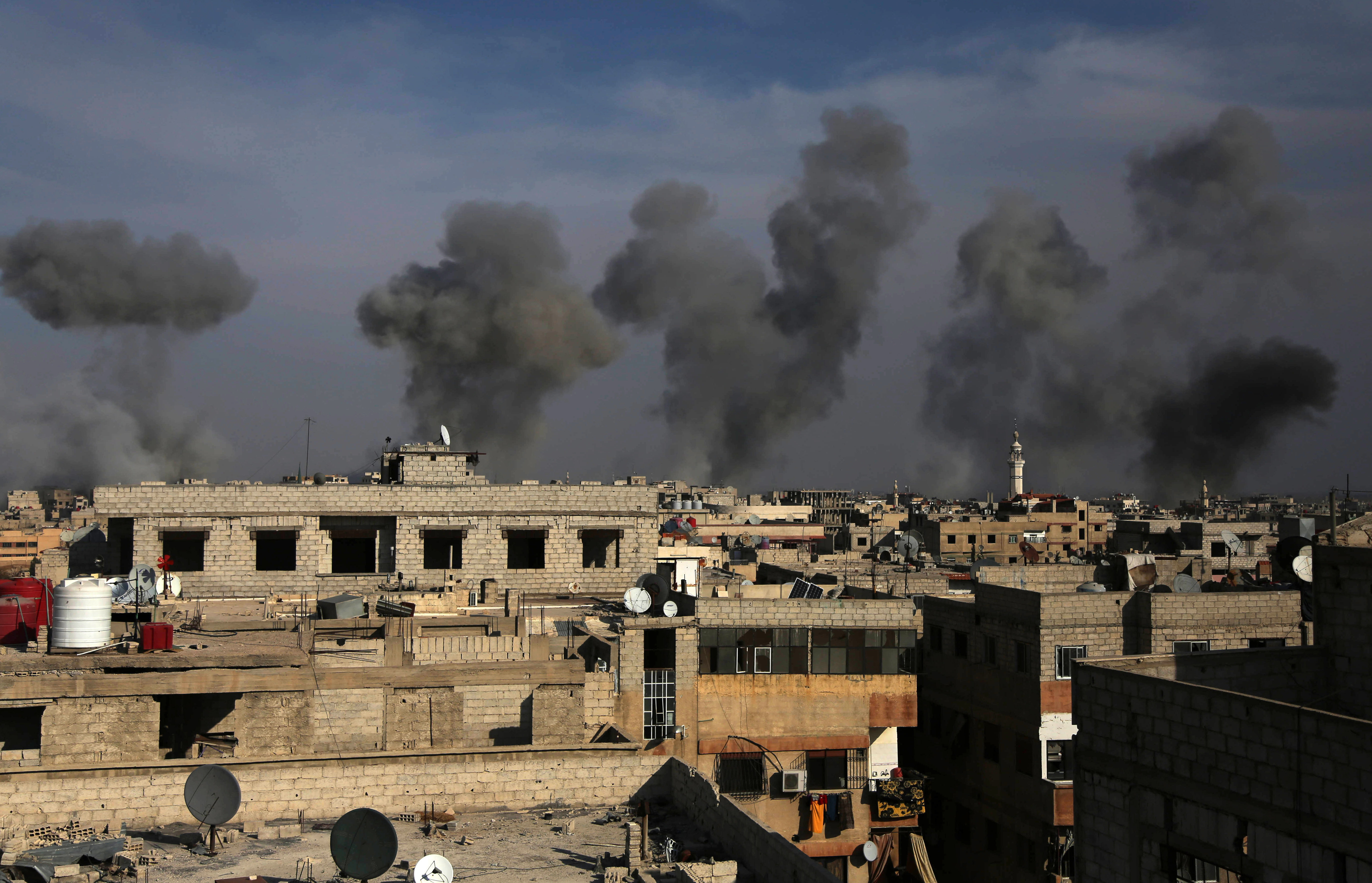 Smoke billows after air strikes by regime forces on the town of Douma in the eastern Ghouta region, a rebel stronghold east of the capital Damascus, on December 13, 2015