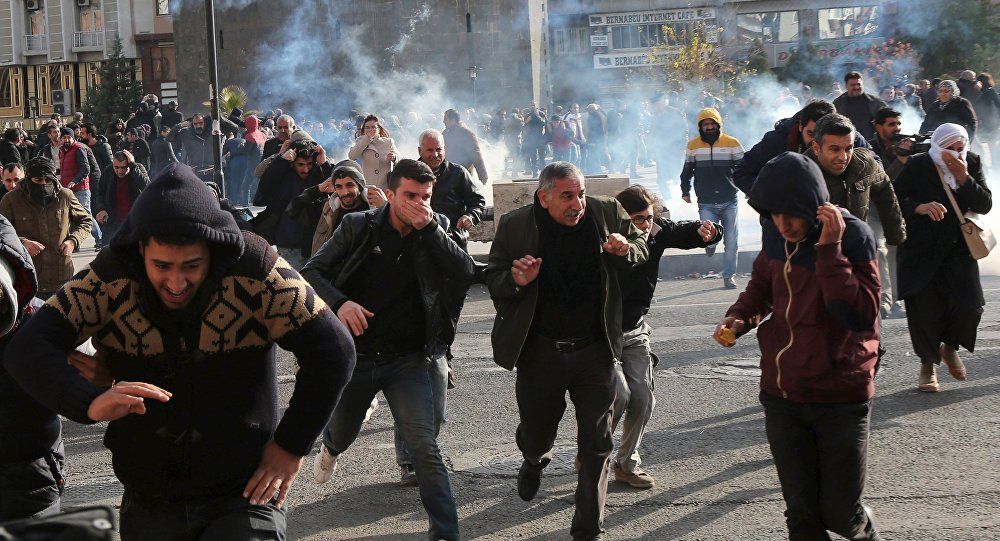 Riot police fire tear gas to disperse demonstrators during a protest against the curfew in Sur district, in the southeastern city of Diyarbakir, Turkey, December 14, 2015