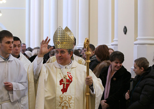 Roman Catholic Archbishop Ivan Jurkovic (center) conducts Easter Mass at the Roman Catholic Cathedral of the Immaculate Conception of the Blessed Virgin Mary