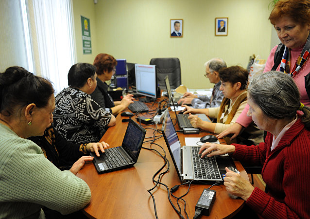 A woman at the Troitsky branch daytime social services work center training to use a personal computer