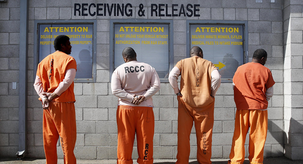 File photo, prisoners from Sacramento County await processing after arriving at the California Department of Corrections and Rehabilitation Deuel Vocational Institution (DVI) in Tracy, Calif