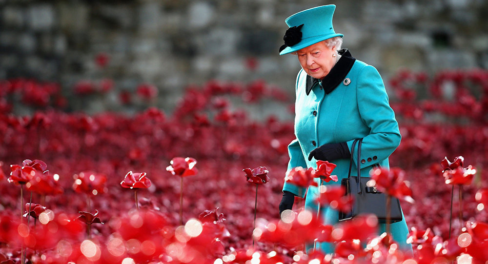 Britain's Queen Elizabeth II visits the Tower of London's 'Blood Swept Lands and Seas of Red' poppy installation in central London.