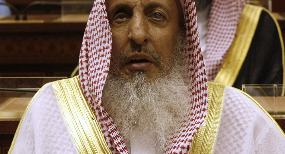 Sheikh Abdul Aziz al-Sheikh, the Saudi grand mufti listens to a speech of King Abdullah of Saudi Arabia at the Consultative Council in Riyadh, Saudi Arabia, Tuesday, March 24, 2009.
