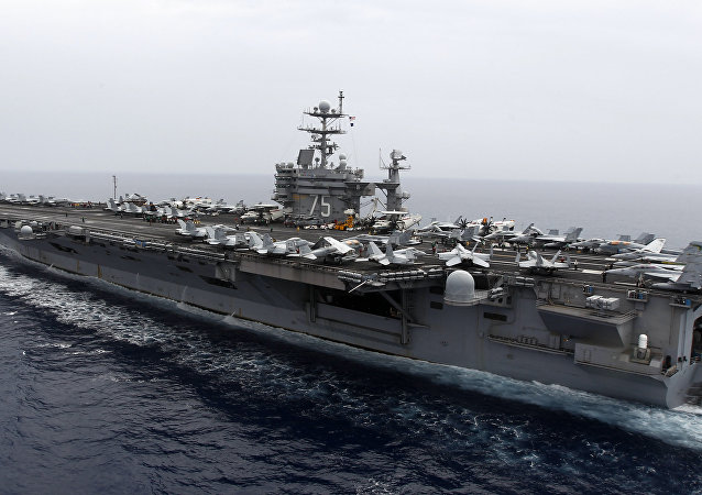 A general view shows the nuclear-powered aircraft carrier USS Harry S. Truman at an undisclosed position in the Mediterranean Sea, south of Sicily, Monday June 14, 2010