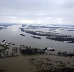 In this aerial photo, the Mississippi River flows out of its banks Wednesday, Dec. 30, 2015, near West Alton, Mo. A rare winter flood threatened nearly two dozen federal levees in Missouri and Illinois on Wednesday as rivers rose, prompting evacuations in several places.