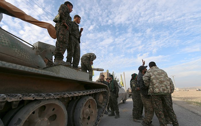 Fighters from the Democratic Forces of Syria prepare themselves ahead of what they said was an offensive against Islamic State militants to take control of Tishrin dam, south of Kobani, Syria December 26, 2015